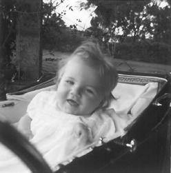 Smiling Louise sitting in the carriage pram where Jean found her having the first seizure