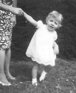 Louise learning to walk with the ever present hand of her mother Jean